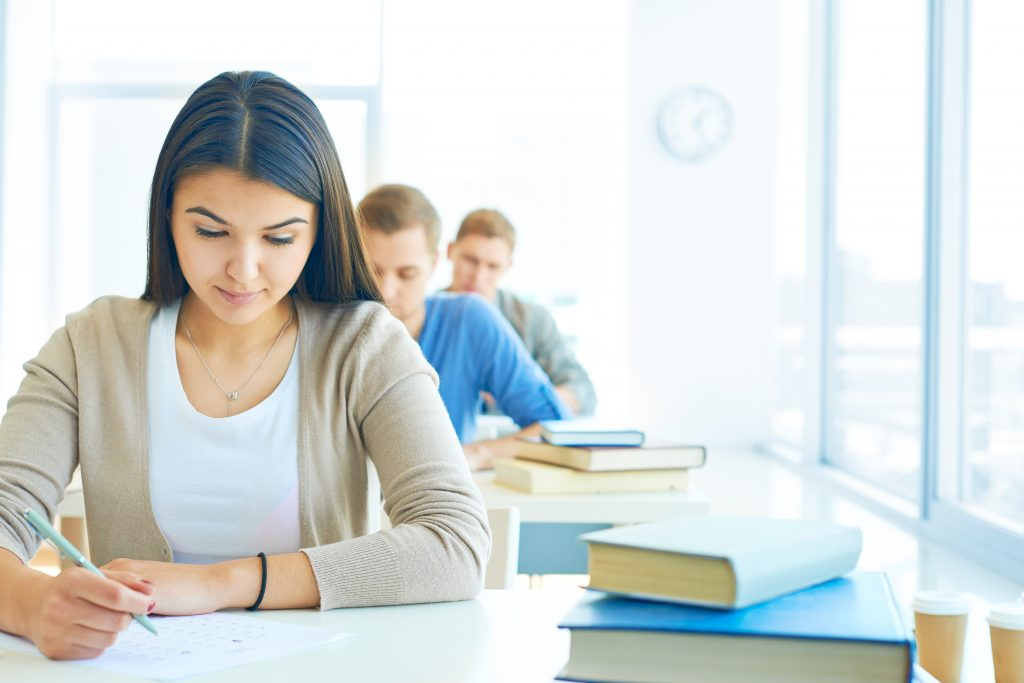 Portrait of pensive student carrying out test at lesson
